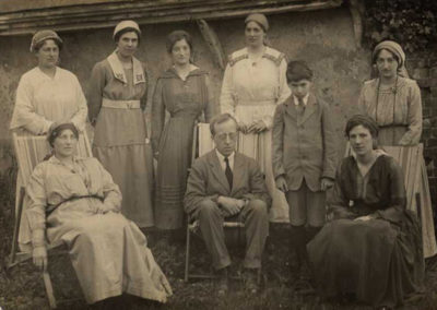 Holst with Isobel to his left with possibly Vally Lasker standing behind Isobel in Thaxted - reproduced with permission from The Holst Birthplace Trust, The Cheltenham Trust and Cheltenham Borough-Council